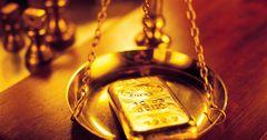 Унция золота аффинированных мерных слитков подорожала еще на $52
