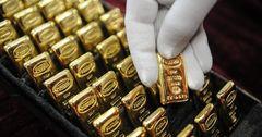 Унция золотых слитков НБ КР подешевела за один вечер