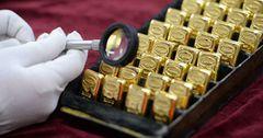 Унция золотых слитков НБ КР за день подорожала на $35